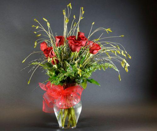 Une douzaine de roses rouges